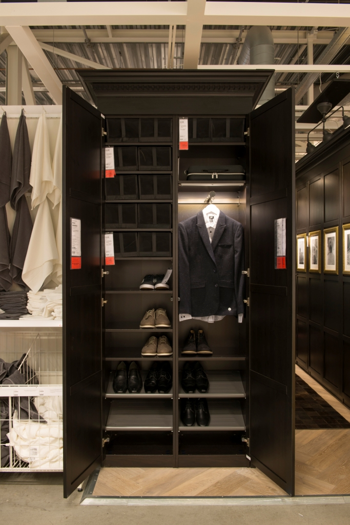 Behind those black panels is the first wardrobe, containing shoes and jackets.
